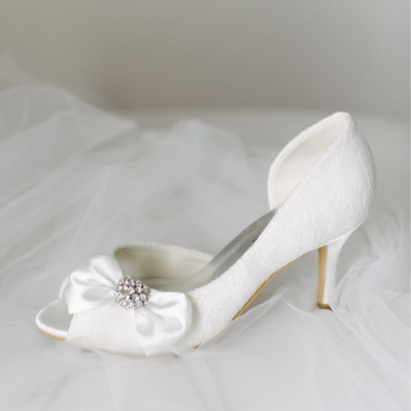 Lace Peeptoe Wedding Shoes by Pearl & Ivory ®  - Find more elegant wedding shoes from our collection www.pearlandivory.com/bridal-shoes.html. Photography by Yolande Marx #PearlandIvory #Bow #WeddingShoes #Lace #Peeptoe #BridalShoes