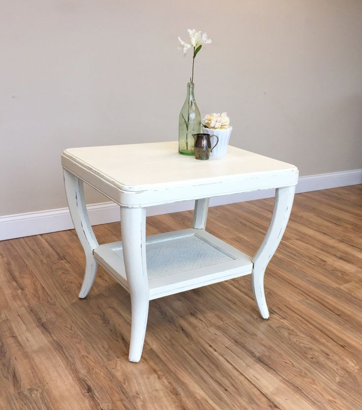 let this distressed white end table add a touch of rustic warmth to your space