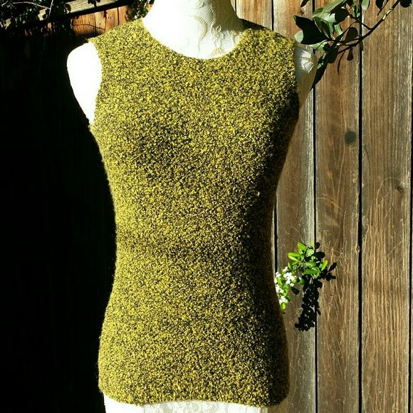VINTAGE HP Black & Gold Sweater Vest 80's Vintage Black and Gold Slim Fit Sweater Vest Picture this with some classic pearls & a black pencil skirt! Extremely soft and comfy. In the sun it looks black and gold, in shade black and chartreuse. Materials: 58% acrylic, 26% nylon, 15% Merino wool, 1% Lycra. Lots of stretch, in excellent condition. Very form fitting, fits more like an XS. Vintage Sweaters