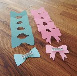 party pins gender reveal baby shower die cut pink girl bows blue boy bow ties or something incorporating paint chip cards which would make it a