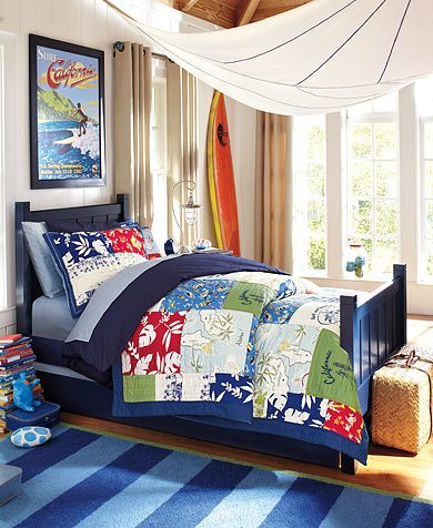 This Island surf bedroom features colorful Pottery Barn Kids bedding and a bold blue striped rug. A great bedroom theme idea for boys who love to surf. For more boys room inspiration visit https://www.facebook.com/BoysRooms you may find something you 'LIKE'