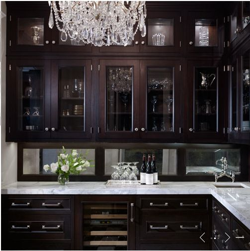 beautiful butler's pantry - love the dark cabinetry and the chandelier