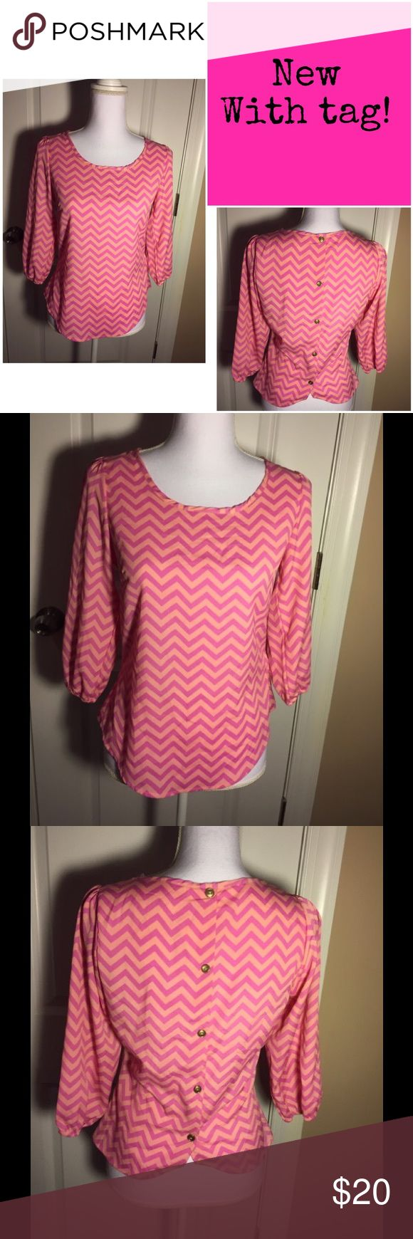 NWT pink chevron blouse New with tag! Peaches N Cream pink chevron blouse. Size small. 100% polyester. Cute back, button detailing. Peaches N Cream Tops Blouses