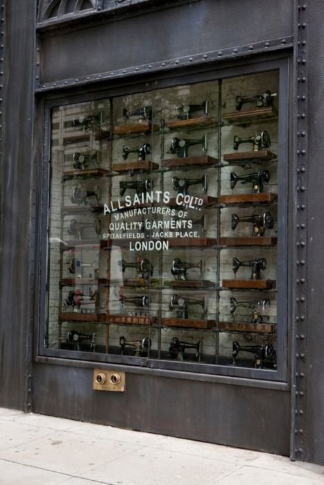 Storefront displaying antique sewing machines