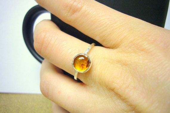 amber ring. Engagement ring Amber energy properties Brings a care free, sunny disposition Promotes good luck and success Dissolves oppositions