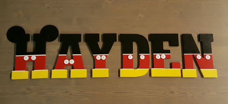 For my grandson's Mickey Mouse themed bedroom I created this wooden name sign in the Mickey theme. I purchased the letters at Hobby Lobby, tapped off sections and painted. I then hot glued the buttons and circle ear pieces. I'm thinking of hanging them on a curtain rod to display in his room!