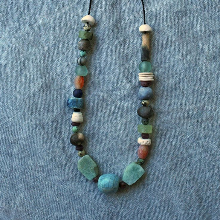 This beautiful beaded necklace is one of my recent makes. My necklaces are inspired by ancient trade beads and no two necklaces are ever the same. They really are handmade and one of a kind. Modern Artefacts ceramic beaded necklace/ colourful artisan porcelain/ Raku/ pit fired beads/ eclectic gemstones/ found objects/ unique/ by CopperLarkStudio on Etsy