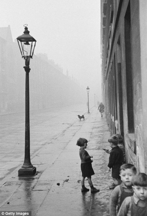 Children in the run-down Gorbals area take to the streets. The tenements there were built quickly and cheaply in the 1840s