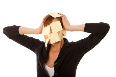 Business woman with sticky notes on her face stock photo