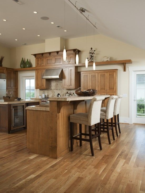 Traditional kitchen with neutral tones - beautiful Oak hardwood floors.