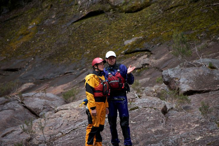 Elias and Franzi having a little meeting about how to raft the next section of white water safely.