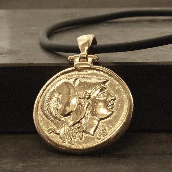 Gold Ancient Greek Coin Necklace, Men Coin Pendant Goddess Athena, Ancient Greece Coin Necklace, Statement Unisex Necklace, Mens Jewelry. Men/Women statement necklace Greek jewelry Coin replica of Tetradrachm of Athens (5th century BC) Obverse: a portrait of Athena, Goddess of wisdom patron goddess of the city, in helmet Reverse: the owl of Athens, with an olive sprig and the inscription ΑΘΕ ( of the Athenians )  Sterling silver pendant 24 karat gold plated on gold nylon coated wire or o...