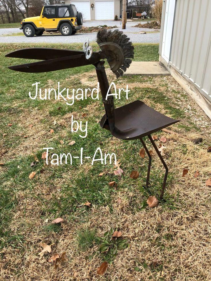 Junkyard Art by Tam-I-Am. Repurposed shovel and trimmers make up this bird feeder. Scrap metal art.