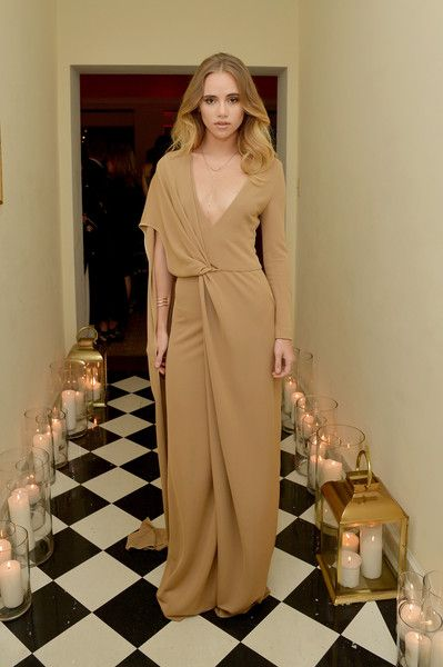 Suki Waterhouse in a nude draped, wrap dress with a plunging V-neck. (Photos)