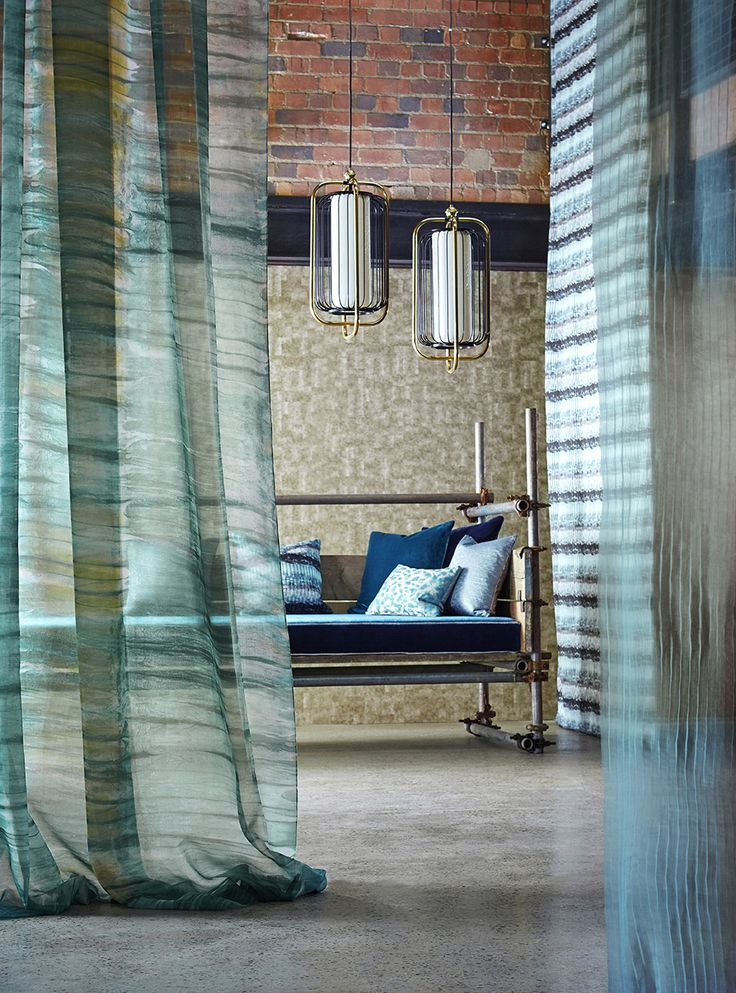 Combine 'Veda', Anthology's luxurious velvet with a delicate sheer such as 'Yuti', a painterly striped voile or 'Stria' an ombre effect pleated sheer. Hanging fabric panels is a great way to cleverly divide an open plan living space into specific areas.