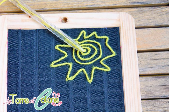 Awesome project: velcro tape on wooden board (recycling wool scraps)