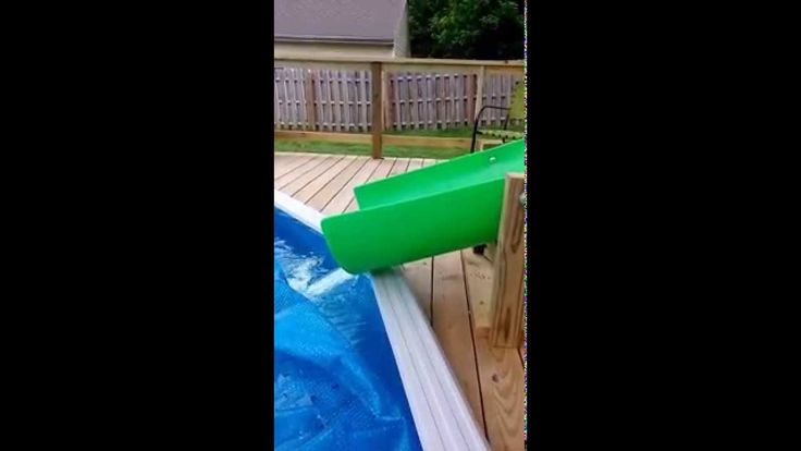 This is my custom homemade 14' water slide going into a 21' above ground pool. The slide itself is a 14' plastic playground slide custom ordered. Slide is at...