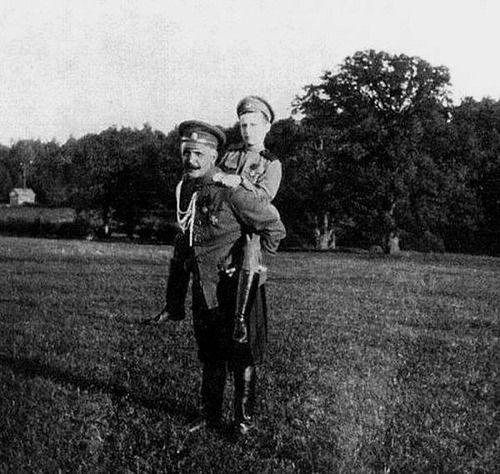 """Alexei getting a piggyback ride from the commander of the Standart, Nikolai Sablin ~   Nikolai himself served in Standart between 1906 and 1914.  In 1914 Sablin became the naval Aide de camp to Tsar Nicholas II and later in World War I commanded a battalion of the Russian Guard. He was dismissed from service after the February Revolution and joined the White Russian forces in Ukraine. Died in Paris. Before death he left his memories about Nikolay II and his family"""