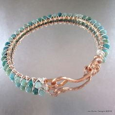 Super gorgeous artisan made gemstone bangle which is formed hammered and sculpted out of sturdy solid 12 gauge copper wire. The green-blue toned 4 mm turquoise jasper round beads, are wire wrapped ont