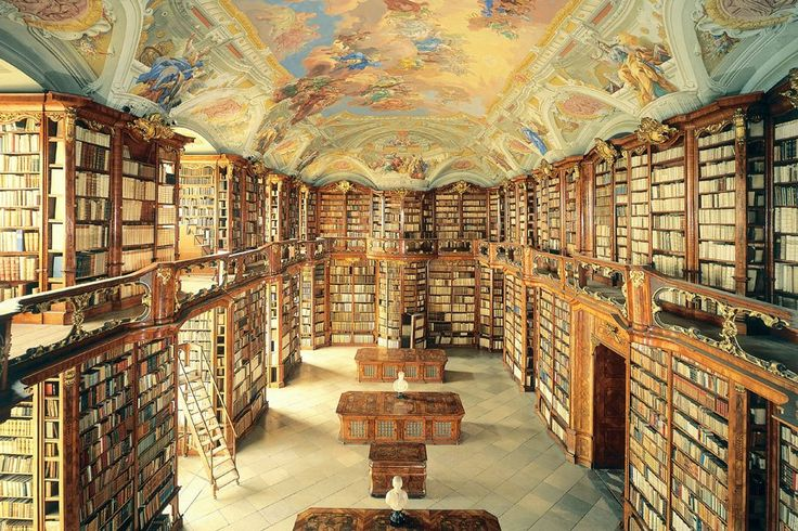 St. Florian Library, Sankt Florian, Austria :: The library's interior is a masterwork of Baroque architecture with elaborate carved-wood bookcases and balustrades with gilded details. A ceiling fresco by Bartolomeo Altomonte, completed in 1747, presents allegorical subjects who watch over the great room from the clouds.