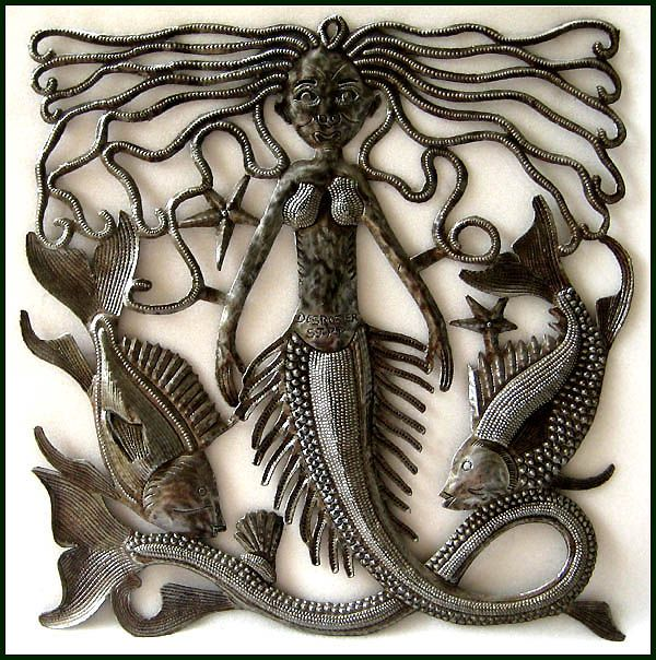 "Mermaid Metal Wall Decor - Metal Art of Haiti - Haitian Steel Drum Art - Handcrafted metal mermaid wall hanging. Created from flattened,recycled steel drum in Haiti. A beautifully balanced wall hanging featuring a lovely mermaid.  Haitian steel drum metal art design.    Measures 17"" x 17"""