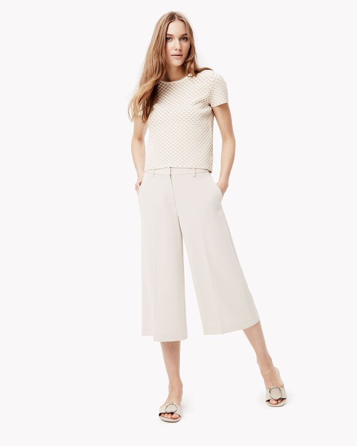 The culotte. The most fashion-forward of our pants for spring, this easy-to-wear crop pant has a super wide flare and comes in an all-season stretch cotton twill with a classic chino look. Sport it with flats and an easy shell top or dress it up with a collared top and a sleek leather belt.