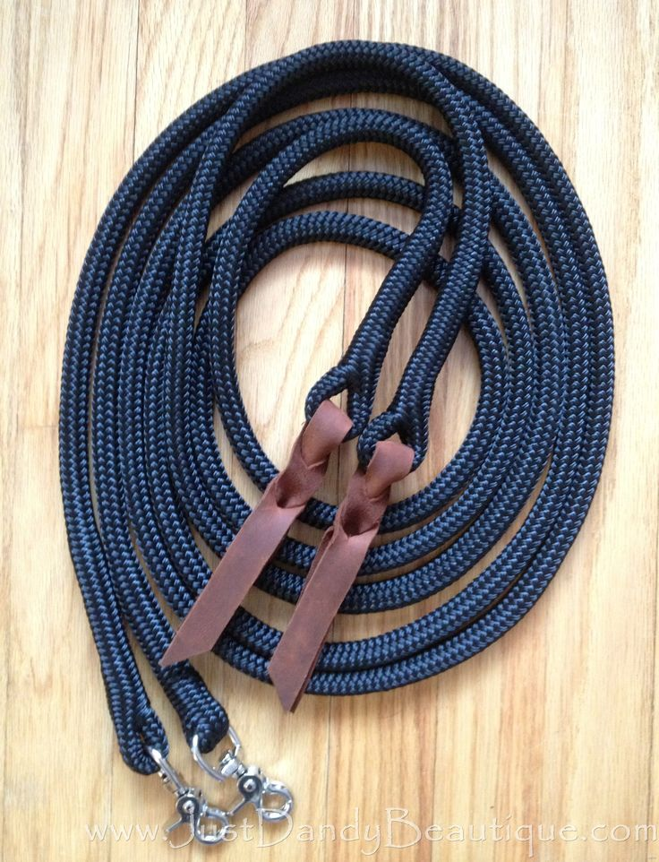 """Made from 1/2 inch marine-grade yacht rope, these reins are hand-spliced.  This rope is a favorite among many of today's top natural trainers as it has a nice """"feel"""", is soft on the hands and is abraision resistant.  It is also rot, mildew and fade resistant.     Included in each set are weighted ends with hand-cut leather poppers in your choice of black or brown as well as your choice of trigger snaps or O ring/safety snap combinations (not shown). #horse #rope #tack #leather #reins"""