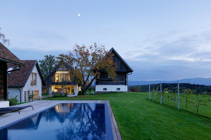 Gangoly & Kristiner Architekten designed a single family house near Graz, assembling a main house and four annexes that used to be traditional farm buildings.