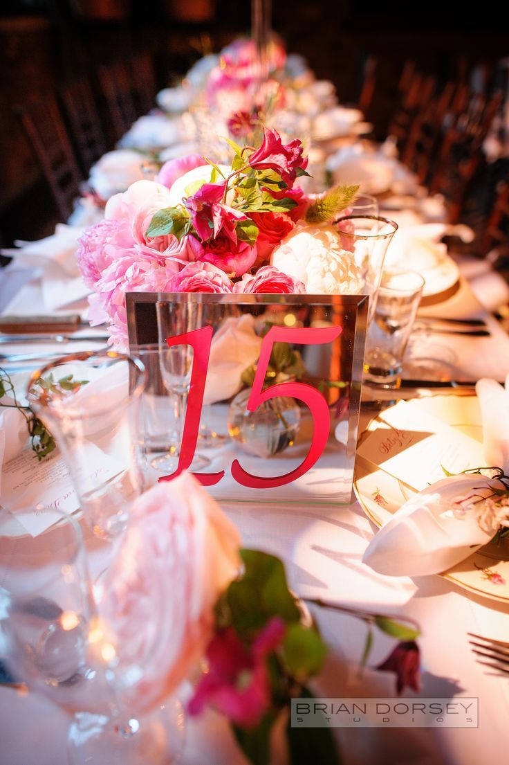 Pink wedding reception centerpiece idea; Featured Photographer: Brian Dorsey Studios