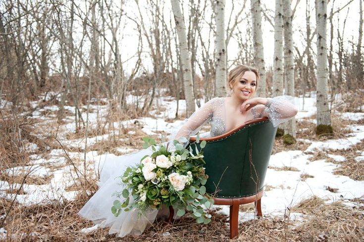 """Winter Hayley Paige bride carries bouquet of greenery captured by Calgary wedding photographer Tara Whittaker 