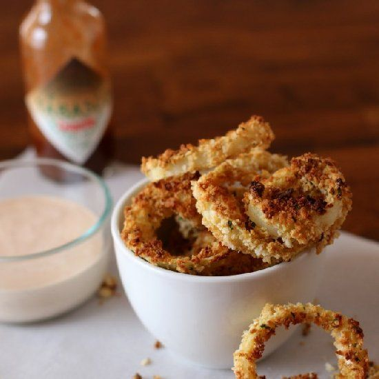 Crispy Baked Onion Rings with Chipotle Ranch Dip.