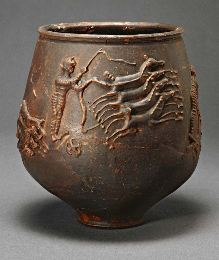 Roman charioteer racing his quadriga on the Colchester circus vase.