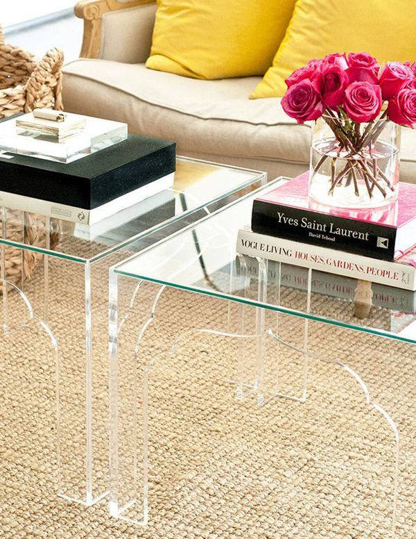 Lucite tables are functional, chic and a good solution in small spaces to keep everything open.