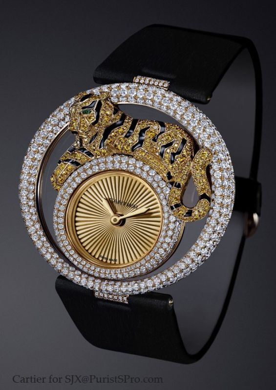 This tiger watch uses white and yellow diamonds, emeralds, and black enamel for the tiger's stripes.