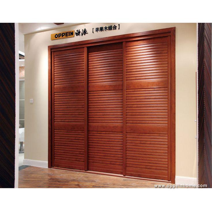 Bedroom furniture item name modern nut brown built in for Modern sliding closet doors