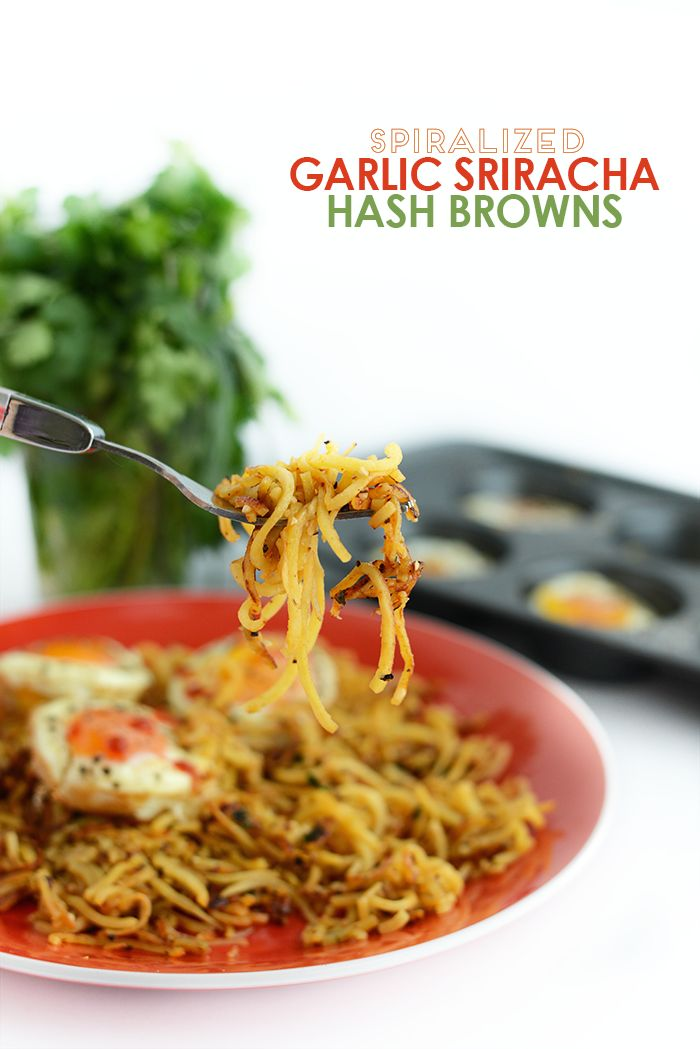 Got a yam? Make these paleo spiralized hash browns flavored with garlic and siriracha for a flavorful and filling breakfast paired with baked eggs!