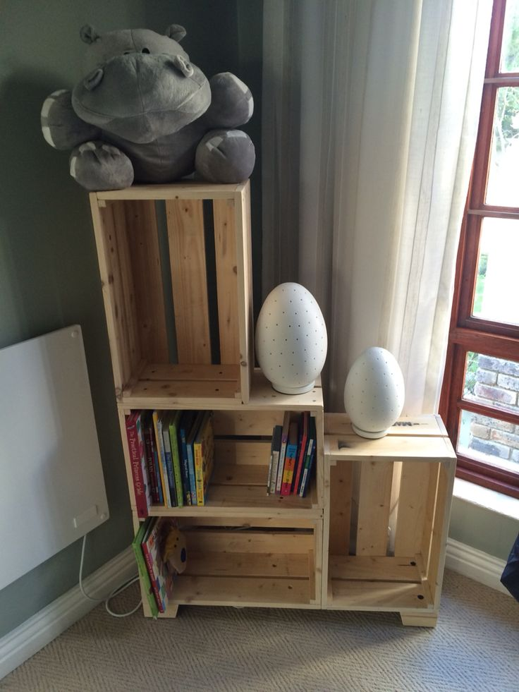 Baby room crate bookshelf made from recycled pallet wood.
