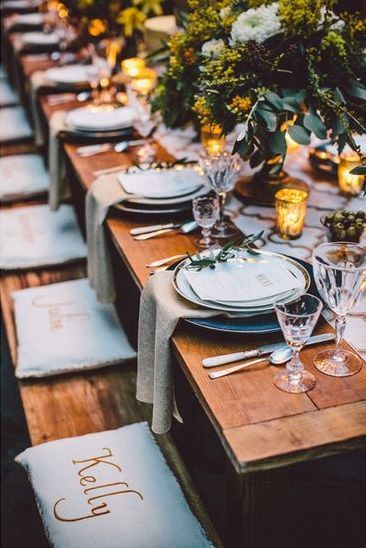 9 Vibrant New Spring Wedding Trends; Place-cards engraved on tables, napkins or chair backs.