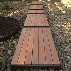 Could have a faux deck feel by doing a composite wood path like this. Floating decks surrounded by rock