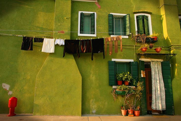 the green house by Ephraim Muller    On our last day in Venice Laura the ultimate tour guide, took us to this beautiful little island 1.5 hours by boat from Venice called Burano..amazing charming little village populated with colourful houses like these across very quaint streets.. was brilliant because it definitely had a very different atmosphere to Venice and even though it's probably bombarded by tourists during the year had a slightly untouched quality about it.. especially off season..