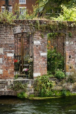 Walled garden on a riverbank in Winchester, Hampshire - what a charming picture.