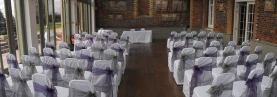 Alternating Dark Silver Organza and Victorian Purple Organza Bows on White Chair Covers