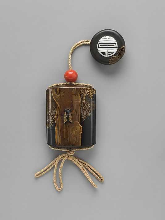 Case (Inrô) with Design of Cicada on Tree Trunk  Period: Edo period (1615–1868) Date: 18th century Culture: Japan Medium: Case: gold and metal on black lacquer with mother-of-pearl inlay; Fastener (ojime): coral; Toggle (netsuke): lacquer medallion with design of chrysanthemums and the Chinese character for longevity