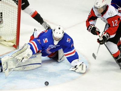 Rangers goalie Joel Vienneau makes a point blank save and dives for the rebound against Niagara Icedogs forward Anthony Difruscia during the first period at the Aud on Sunday.
