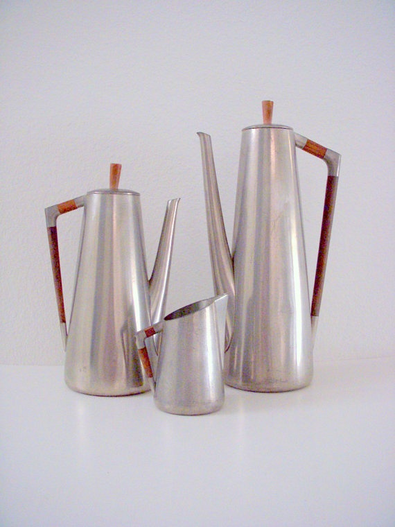 So fabulous. Vintage 50s 60s Danish Modern Pewter Coffee Pot or Tea Set Creamer Teak Handles Minimalist Mid Century Modern KMD Royal Holland Pewter. $35.00, via Etsy.