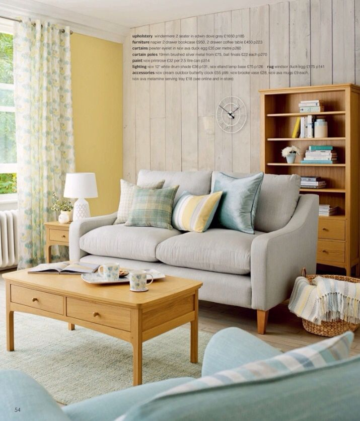 Perfect living room in the Laura Ashley catalogue. Grey, yellow and blue with oak furniture.