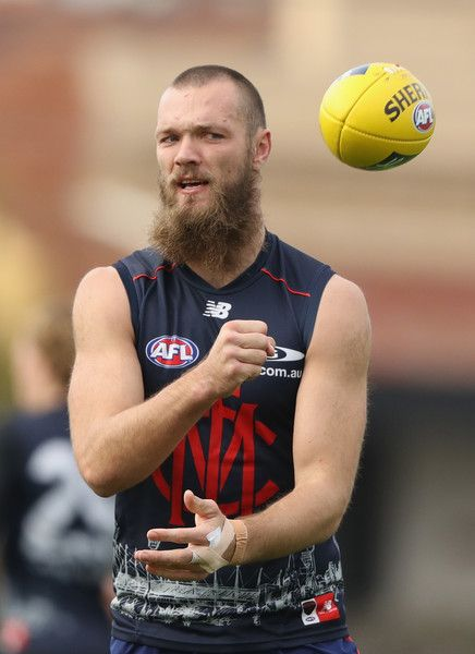 Max Gawn of the Demons handballs during a Melbourne Demons AFL training session at Gosch's Paddock on July 15, 2016 in Melbourne, Australia.