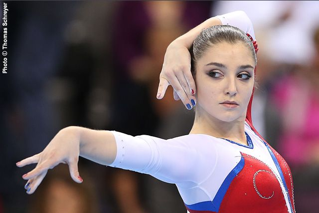 Russian star Aliya Mustafina will not compete at the upcoming world championships in Glasgow because of a back injury, she told media on Friday.