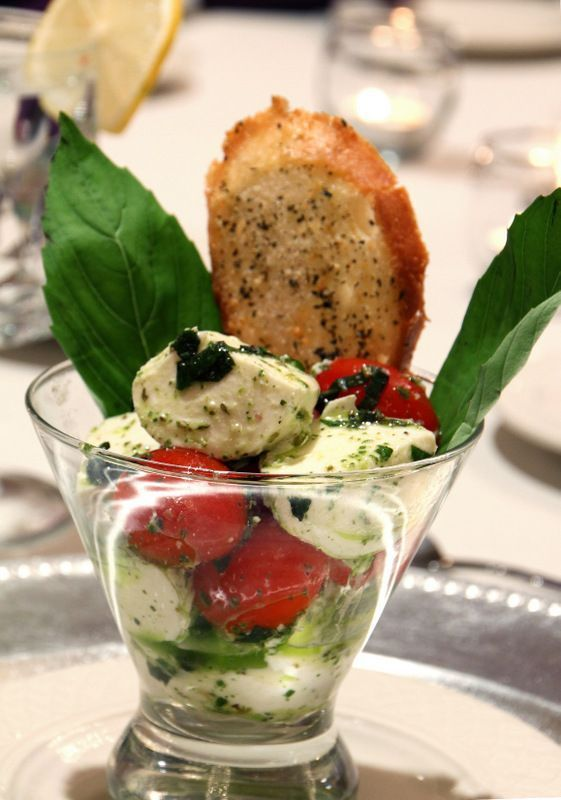 Delicious and pretty caprese salad served in a martini glass for your wedding……