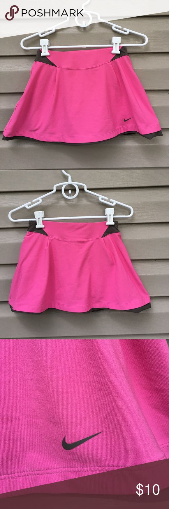 Nike women's pink/ brown tennis skirt Very nice women's dri-fit tennis skirt , shirts underneath, elastic waistband. 88% polyester 12% spandex. No snags stains or holes. ( matching top also available on this site in size Small) Nike Shorts Skorts